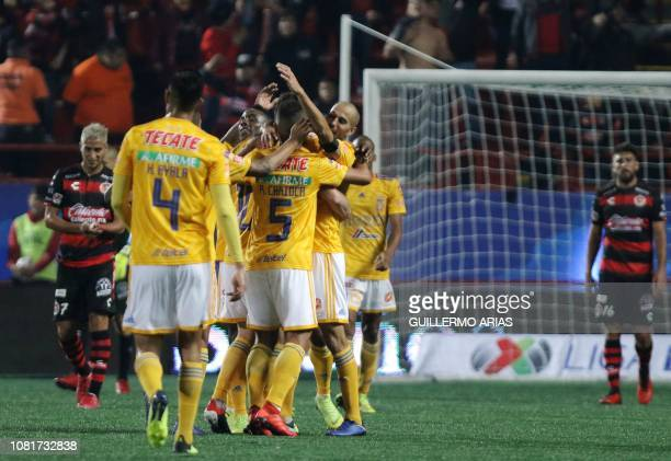 Tigres' players celebrate after scoring during the Mexican Clausura 2019 tournament football match between Club Tijuana and Tigres UANL at Caliente...