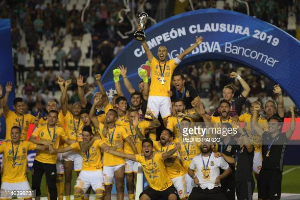 Tigres' players celebrate with the trophy after winning the final match against Leon and the Mexican Clausura tournament 2019 at the Leon stadium on...