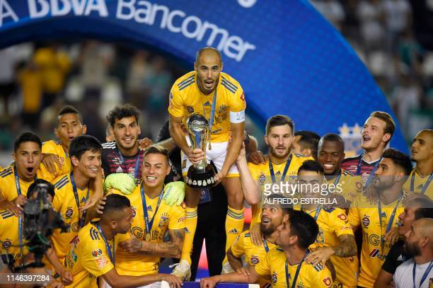 Tigres' players celebrate with the trophy after winning the final match against Leon and the 2019 Mexican Clausura tournament at the Leon stadium on...