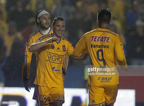Tigres' Rafael Sobis celebrates with teammates after scoring against Veracruz during their 2015 Mexican Clausura tournament football match in...