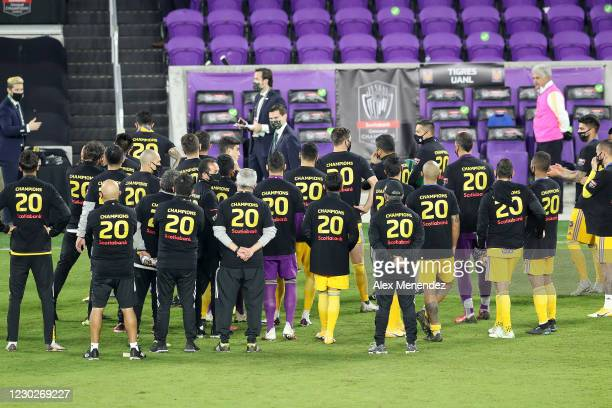 Tigres UANL players wear championship t-shirts after the CONCACAF Champions League final game against Los Angeles FC at Exploria Stadium on December...