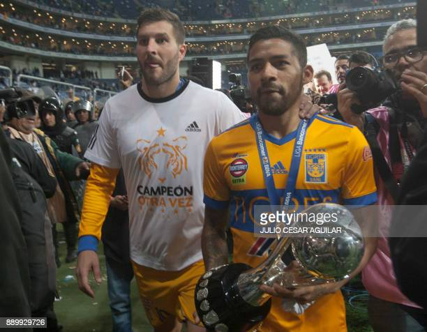 Tigres's Andre Pierre Gignac and Javier Aquino celebrates with the trophy after defeating Monterrey during their Mexican Apertura 2017 tournament...