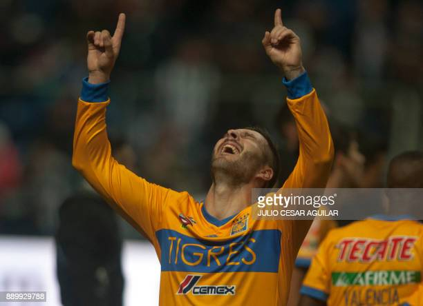 Tigres's Andre Pierre Gignac celebrates after defeating Monterrey during their Mexican Apertura 2017 tournament football final match at the BBVA...