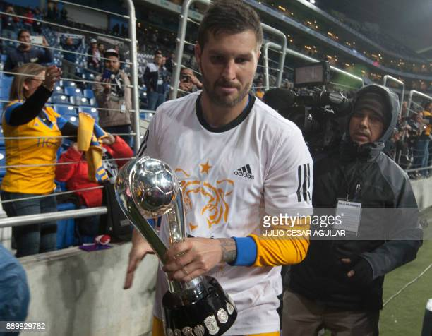Tigres's Andre Pierre Gignac celebrates with the trophy after defeating Monterrey during their Mexican Apertura 2017 tournament football final match...