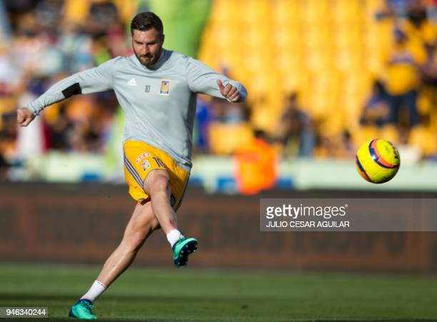 Tigres's French player AndrePierre Gignac warms up before the start of the Mexican Clausura football tournament match against Cruz Azul at the...