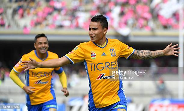 Tigres's Lucas Zelarayan celebrates after scoring a goal against Pumas during their Mexican Apertura 2016 Tournament football match at Olympic...
