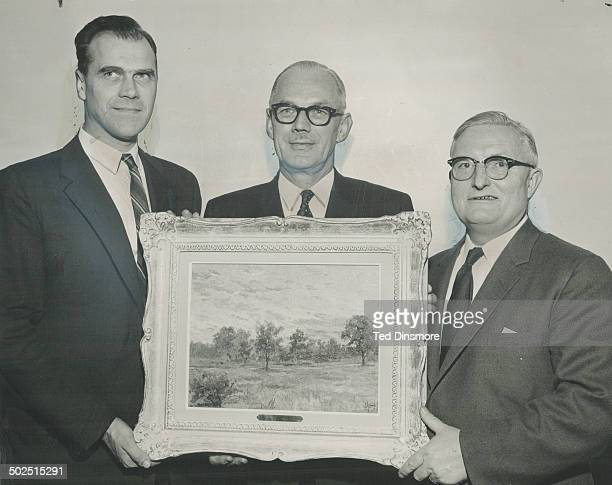 Tihom Hulikovsky left presents painting done by his mother Grand Duchess Olga sister of former Russian czar to Ken Couson and Arthur Creighton...