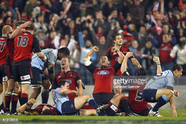 Ti'i Paulo of the Crusaders and team mates celebrate winning the Super 14 final match between the Crusaders and the New South Wales Waratahs at AMI...
