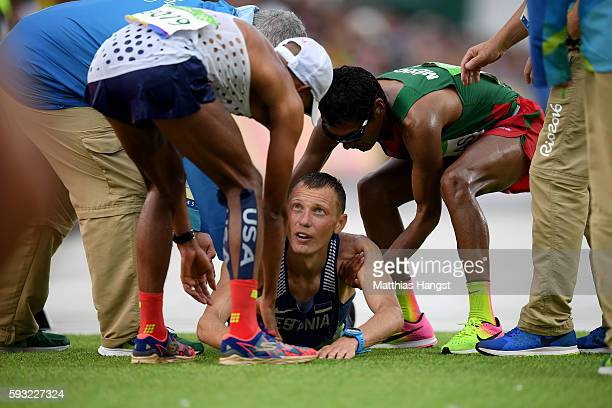 Tiidrek Nurme of Estonia is assisted at the finish line during the Men's Marathon on Day 16 of the Rio 2016 Olympic Games at Sambodromo on August 21...