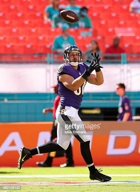 Tiight end Owen Daniels of the Baltimore Ravens takes part in drills before the Ravens met the Miami Dolphins in a gam at Sun Life Stadium on...