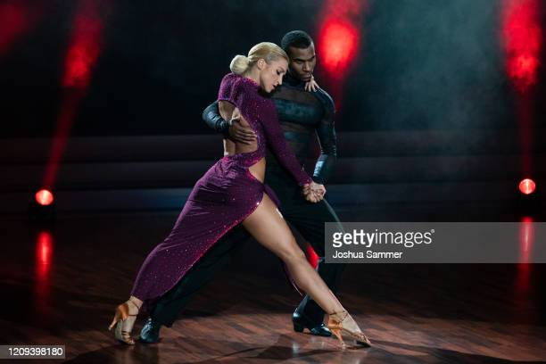 Tijan Njie and Kathrin Menzinger perform on stage during the 1st show of the 13th season of the television competition Let's Dance on February 28...