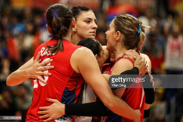 Tijana Boskovic of Serbia celebrates with teammates after winning a point during the FIVB Women's World Championship final between Serbia and Italy...