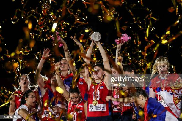 Tijana Boskovic of Serbia holds up the trophy during the victory ceremony of FIVB Women's World Championship final between Serbia and Italy at...
