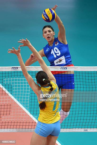 Tijana Boskovic of Serbia spikes as Alena Omelchenko of Kazakhstan blocks during the FIVB Women's World Championship pool F match between Serbia and...