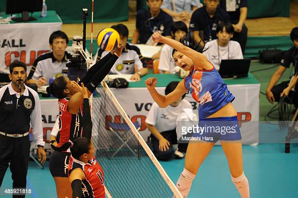 Tijana Boskovic of Serbia spikes in the match between Dominican Republic and Serbia during the FIVB Women's Volleyball World Cup Japan 2015 at Sendai...
