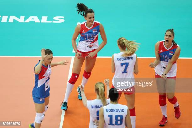 Tijana Malesevic #7 Ana Antonijevic #16 Milena Rasic and Jelena Blagojevic of Serbia and team mates celebrate a point during the match between Serbia...