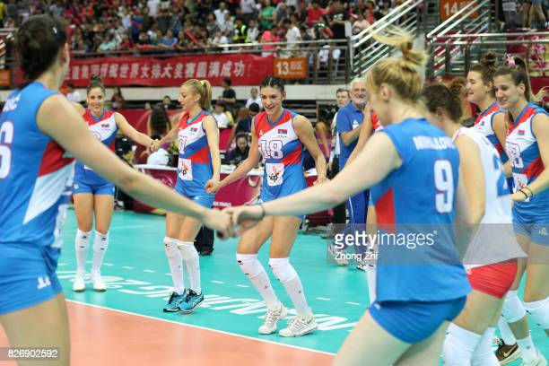 Tijana Malesevic #7 Ana Antonijevic #18 Tijana Boskovic #4 Bojana Zivkovic #13 Ana Bjelica and team mates of Serbia dance and celebrate winning the...
