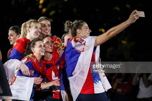 Tijana Malesevic of Serbia takes selfie with teammates during the victory ceremony of FIVB Women's World Championship final between Serbia and Italy...