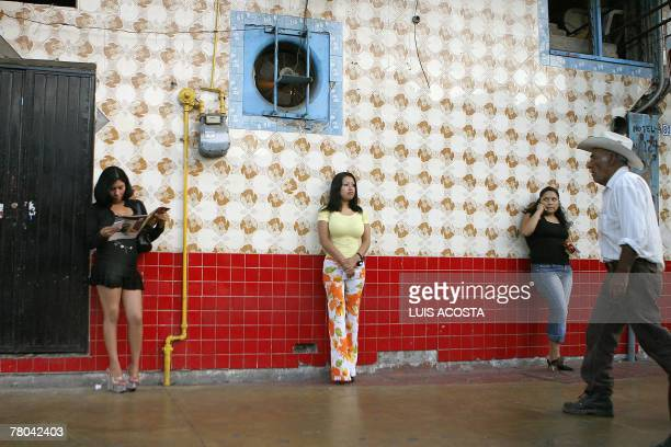 STORY Tijuana A City Under the Shadow of a Double Wall Mexican prostitutes wait for clients on a street of Tijuana city Baja California state 06...