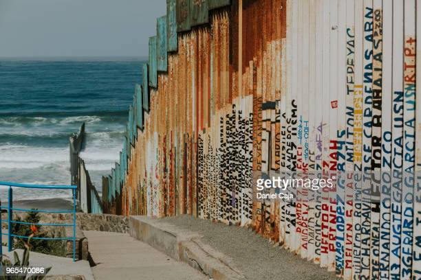tijuana, boarder to us - geographical border stock pictures, royalty-free photos & images