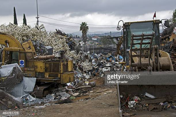 CONTENT] Tijuana junk yard located near the headquarters for the Missionaries of Charity Scraps of aluminum and recoiled scrap fill the yard