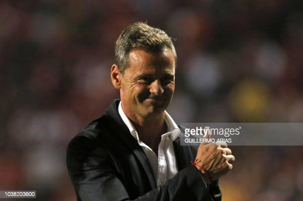 Tijuana's head coach Diego Cocca smiles at fans at the end of the Mexican Apertura tournament football match against Pachuca at the Caliente stadium...
