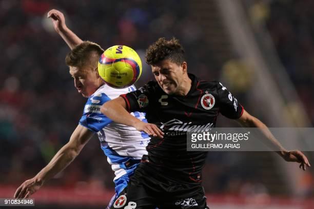 Tijuana`s midfielder Uruguayan Jose Rivero vies for the ball with Puebla`s forward Bolivian Alejandro Chumacero during their Mexican Clausura 2018...
