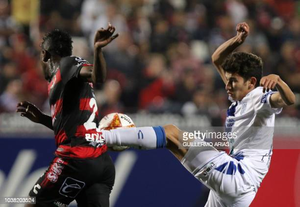 Tijuana's Miler Bolanos vies for the ball against Pachuca's Francisco Figueroa during their Mexican Apertura tournament football match at the...