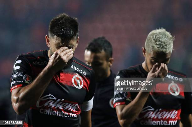 Tijuana's players react at the end of the Mexican Clausura 2019 tournament football match against Tigres UANL at Caliente Stadium in Tijuana on...