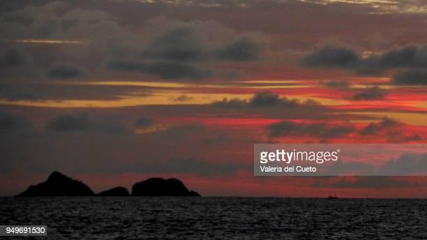 Tijucas islands on colorful horizon from Ipanema
