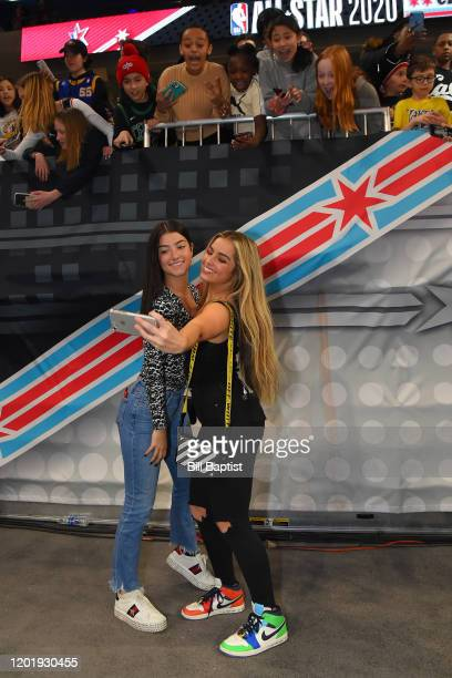 Tik Tok Stars Addison Rae Easterling and Charli D'Amelio take a selfie with fans during Practice and Media Availability presented by ATT as part of...