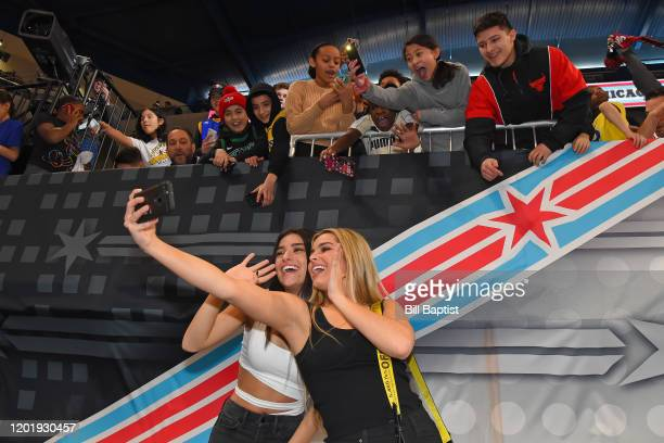 Tik Tok Stars Addison Rae Easterling and Dixie D'Amelio take a selfie with fans during Practice and Media Availability presented by ATT as part of...