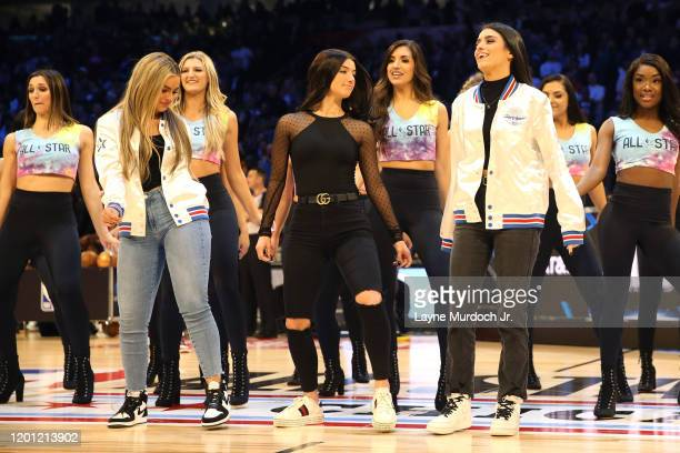 Tik Tok Stars Addison Rae Easterling Charli D'Amelio and Dixie D'Amelio dance during a timeout during NBA AllStar Saturday Night Presented by State...