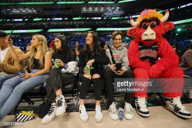 Tik Tok Stars Addison Rae EasterlingDixie D'Amelio Charli D'Amelio Dixie D'Amelio and Chase Hudson with the Bulls mascot during NBA AllStar Saturday...