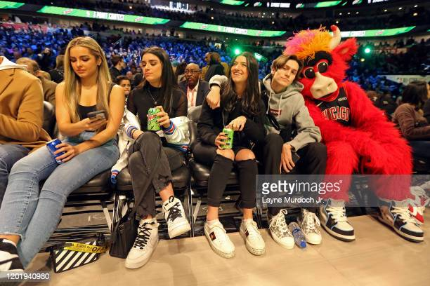 Tik Tok Stars Charli D'Amelio Addison Rae Easterling Dixie D'Amelio and Chase Hudson pose for a photo with Benny the Bull during NBA AllStar Saturday...