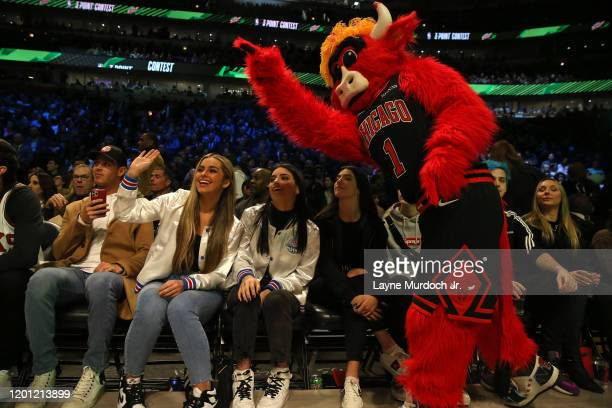 Tik Tok Stars Charli D'Amelio Addison Rae Easterling Dixie D'Amelio with the Bulls mascot during NBA AllStar Saturday Night Presented by State Farm...