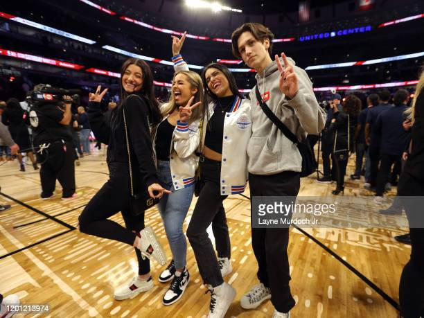 Tik Tok Stars Charli D'Amelio Dixie D'Amelio Addison Rae Easterling Chase Hudson dance during a timeout during NBA AllStar Saturday Night Presented...