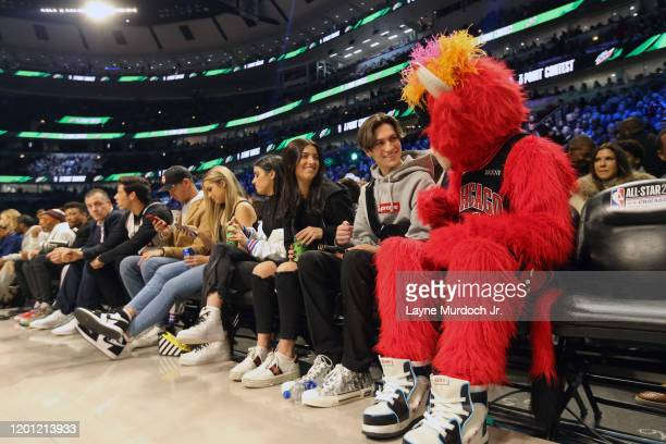 Tik Tok Stars Dixie D'Amelio and Chase Hudson chat with the Bulls mascot during NBA AllStar Saturday Night Presented by State Farm as part of 2020...