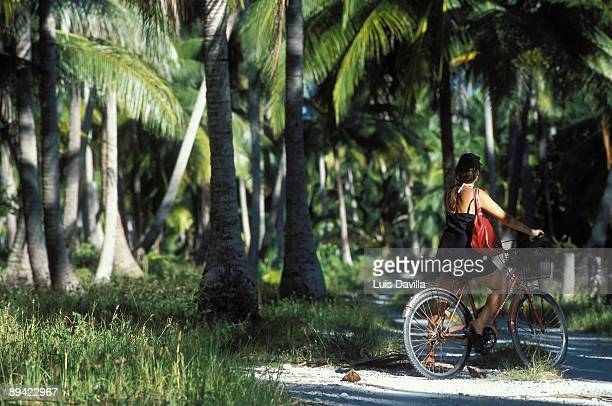 Tikehau Tuamotu French Polynesia In the image woman riding on a bicycle in Tikehau