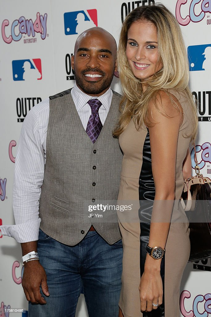 Tiki Barber and his wife Traci Lynn Johnson attend the CCandy Children's Clothing Line Launch at MLB Fan Cave on August 8, 2013 in New York City.