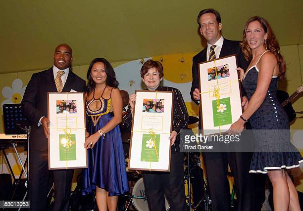 Tiki Barber and wife Ginny Maxine Clark and Tod Waterman and Allison Waterman except an award at the Fresh Air Funds Annual Spring Gala to Salute...
