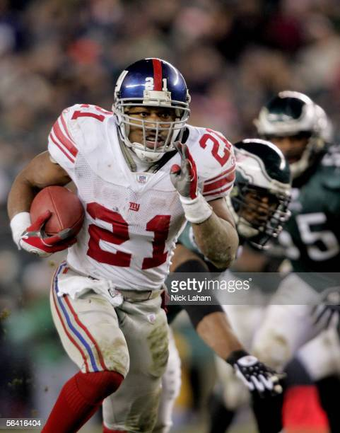 Tiki Barber of the New York Giants carries the ball in the game against the Philadelphia Eagles on December 11, 2005 at Lincoln Financial Field in...