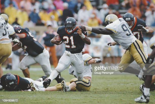 Tiki Barber Running Back for the University of Virginia Cavaliers during the NCAA Atlantic Coast Conference college football game against the Georgia...
