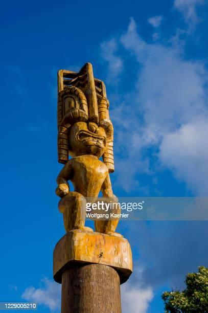 Tiki carvings in front of tribal art store in Hanalei on Kauai Island, Hawaii, USA.