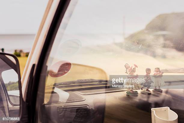 tiki dolls on car dashboard - car decoration stock pictures, royalty-free photos & images