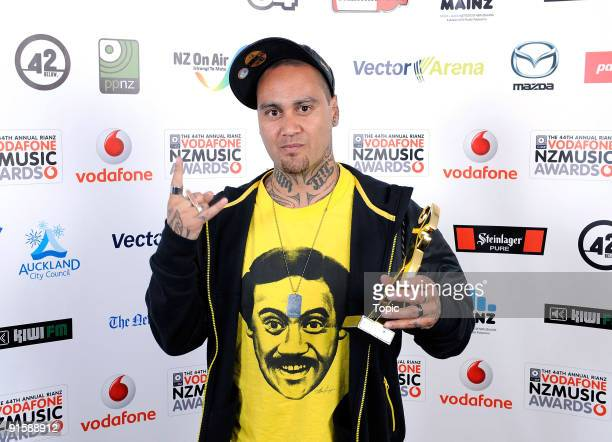 Tiki Taane poses with the award for New Zealand of Air Radio Airplay Record of the year during the 2009 Vodafone Music Awards at Vector Arena on...