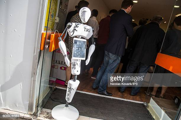 Tiki the robot which belongs to the Event Bots Society welcomes the public at the entrance of Robot Lab showroom on September 13 2016 in Paris France...