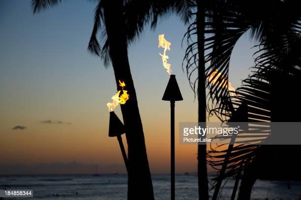 Tiki torch flames at dusk, Oahu, Hawaii