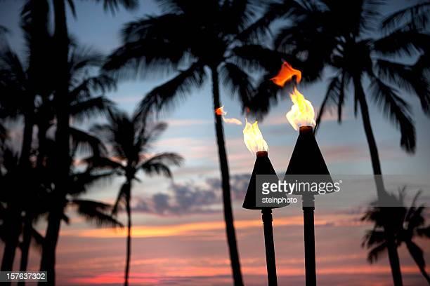 Tiki Torch Flames At Sunset