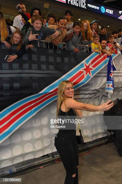 Tiki's Tok Star Addison Rae Easterling takes a selfie with fans during Practice and Media Availability presented by ATT as part of 2020 NBA AllStar...